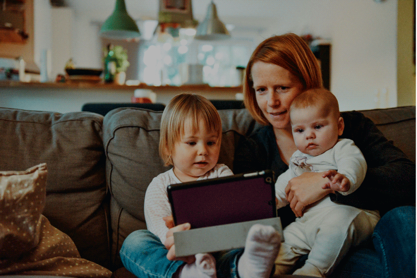 Family looking at a smartphone - What are good money habits?