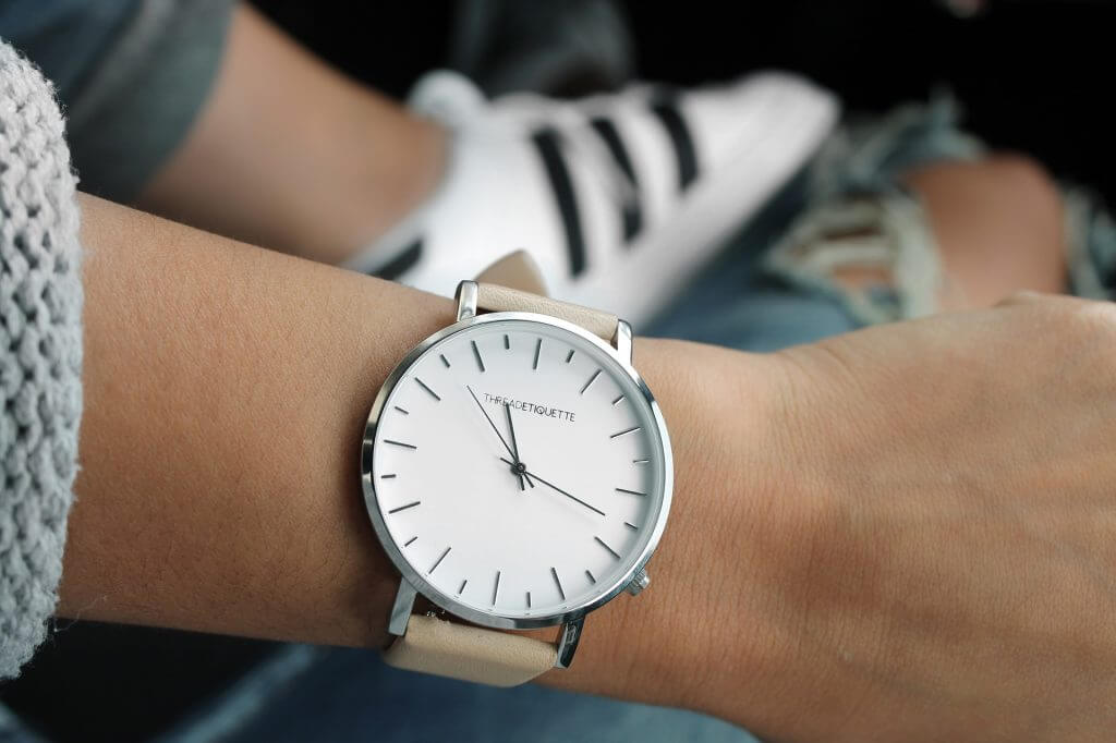 Woman wearing wristwatch: time management tools for women