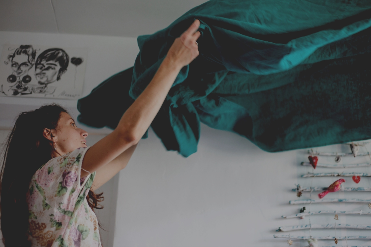 Woman making bed: How The Women's PowerTypes can be useful in daily life
