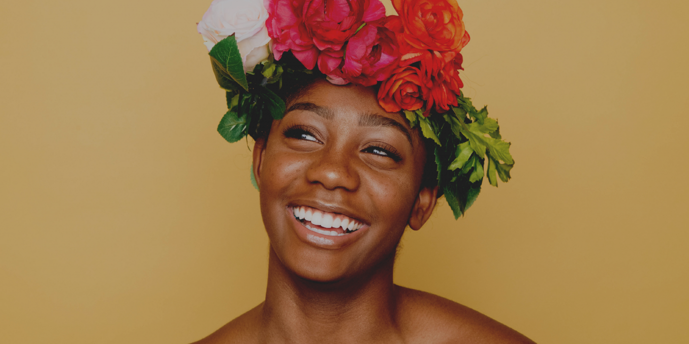 Woman smiling: But is positive thinking good for you?