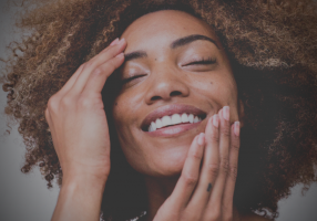 Smiling woman with eyes closed: How to put yourself first