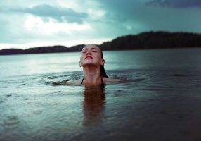 Woman awimming: How to breathe when you're feeling stress about stress