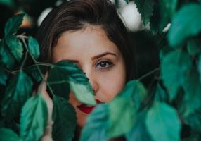 Woman behind leaves: How to cope with bereavement