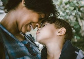 Woman and child laughing: How to stay sane during the holidays